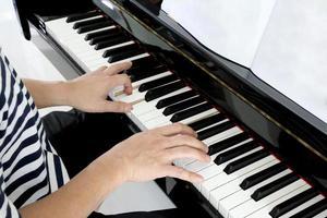 Asian Man Playing Piano photo