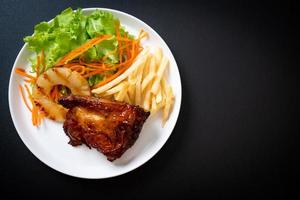 Grilled chicken steak with vegetable and french fries photo