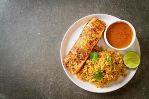 Pan-seared salmon tandoori with masala rice - Muslim food style photo