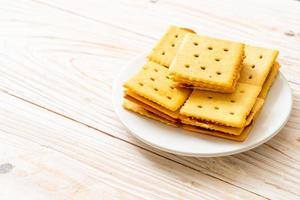 Cheese biscuits with pineapple jam on wood background photo