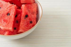 Fresh watermelon sliced in white bowl photo