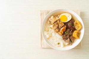 Paste of rice flour or boiled Chinese pasta square with pork in brown soup - Asian food style photo