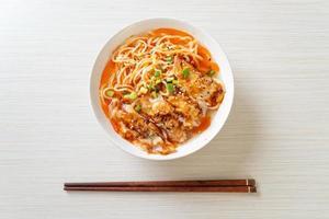 Ramen noodles with gyoza or pork dumplings - Asian food style photo
