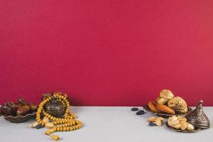 Dried fruit, nuts, and beads photo