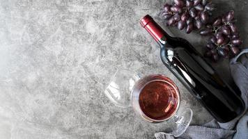 Top view delicious organic wine and grapes. High quality beautiful photo concept