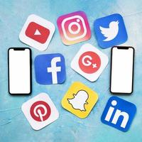 Social media icons with two blank cellphone blue painted wall. High quality beautiful photo concept