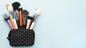 Small bag with makeup brushes. High quality beautiful photo concept