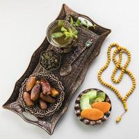 Tea glass with dates fruit beads tray. High quality beautiful photo concept