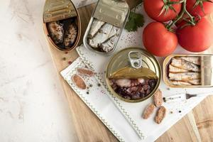 Top view seafood cans with tomatoes. High quality beautiful photo concept