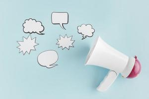 Top view megaphone with chat bubbles. High quality beautiful photo concept