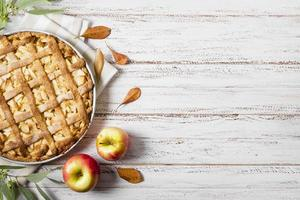 Top view apple pie thanksgiving with leaves copy space. High quality beautiful photo concept