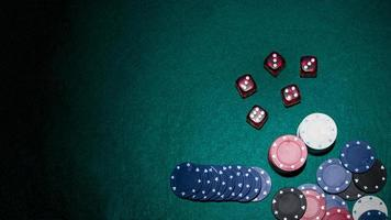 Red dice casino chips green poker table. High quality beautiful photo concept