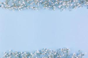White baby breath s flower border blue background with copy space writing text. High quality beautiful photo concept