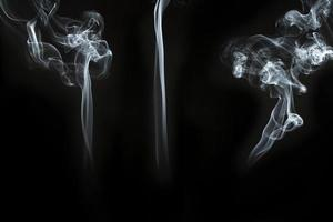 Three great silhouettes smoke black background. High quality beautiful photo concept