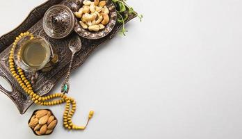 Tea glass with nuts beads tray. High quality beautiful photo concept
