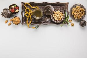 Tea glass with different nuts beads. High quality beautiful photo concept