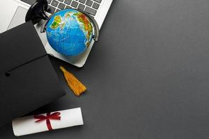 Top view laptop with diploma globe. High quality beautiful photo concept