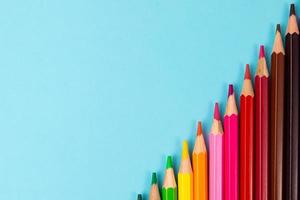 Color pencils isolated on paper background photo