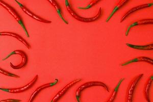 Hot red chili isolated on paper background. photo