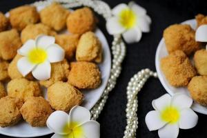 Delicious bakery food items with flowers photo