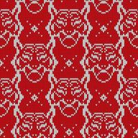 Seamless knitted pattern witn tiger silhouette. vector