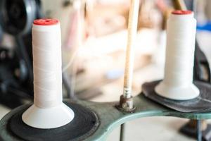 Thread and sewing machine photo