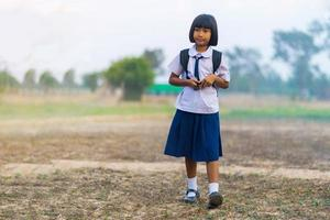 Asian student in uniform studying at countryside of Thailand photo