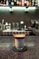 Dirty coffee cup, espresso coffee with milk in cafe bar photo