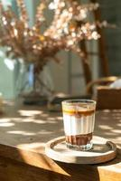 Double dirty coffee cup - espresso coffee with milk and chocolate in coffee shop cafe photo