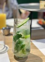 Mojito cocktail with lime and mint in  glass photo