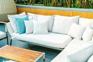 Comfortable pillows on outdoor patio chair and table in garden photo