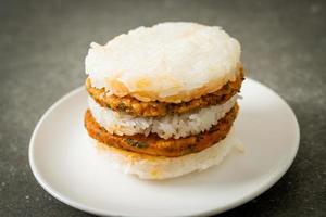 Homemade grilled spicy pork and herbs with sticky rice burger photo