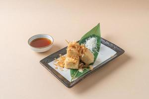 Aged dashi tofu crispy deep-fried tofu served with soy sauce - Japanese food style photo