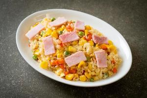 Homemade fried rice with ham and mixed vegetables of carrot, green bean peas, and corn photo