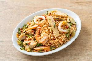Instant noodle spicy salad with mixed meats photo