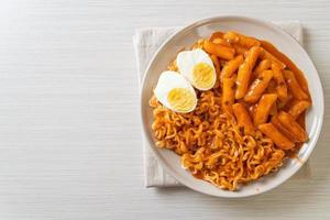 Rabokki or Ramen or Korean instant noodle and Tteokbokki in spicy korean sauce photo