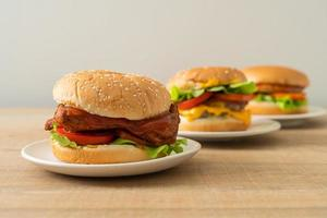 Grilled chicken burger with sauce on white plate photo