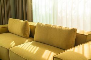 Empty golden mustard sofa in living room photo