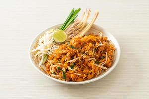 Stir-fried noodle with tofu and sprouts or Pad Thai - Asian food style photo