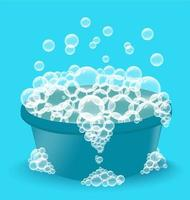 Blue plastic basin with soap suds. Bowl with bubbles vector