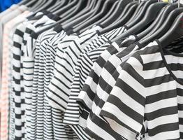 Clothes hang on shelf photo
