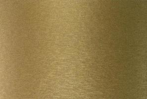 Sheet of textured alboom cover. Cardboard golden texture photo
