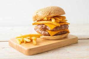 Paork hamburger or pork burger with cheese and french fries photo