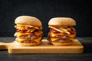 Pork hamburger or pork burger with cheese, bacon and french fries photo