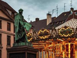 Glowing lights of a classic French carousel in Strasbourg, France photo