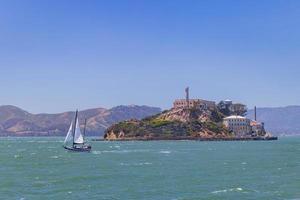 Sunny view of the Alcatraz Island and San Francisco Bay with a boat photo
