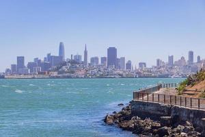 Sunny view of the Alcatraz Island and San Francisco skyline photo