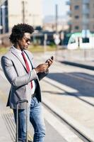 Black Businessman wearing suit waiting his train photo