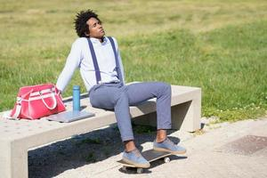 Black man with afro hair taking a coffee break photo