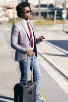 Black Businessman waiting for the next train photo